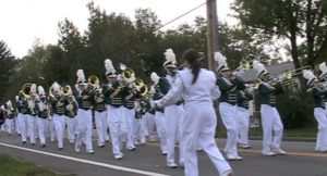 The marching band participates in the Homecoming parade. (file photo)