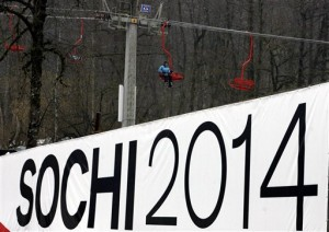 A skier rides on a ski lift past a billboard promoting the bid to host the 2014 Winter Olympic Games in the Russian resort of Krasnaya Polyana during a visit by International Olympic Committee inspectors in the Krasnaya Polyana area outside the Black Sea resort of Sochi, southern Russia, in this Wednesday, Feb 21, 2007, file photo. Sochi is competing against Salzburg, Austria, and Pyeongchang, South Korea. One bid offers a traditional Alpine setting in the heart of Europe. Another promises a unique coastal and mountain layout on the Black Sea. A third trumpets the opening of a winter sports frontier in Asia. The International Olympic Committee is faced with three very different proposals for the 2014 Winter Games, and there is no telling which will prevail as the bid campaign enters its final days. (AP Photo/ Mikhail Metzel, File)