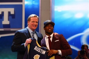 Tavon Austin, from West Virginia, stands with NFL Commissioner Roger Goodell after being selected eighth overall by the Saint Louis Rams in the first round of the NFL football draft, Thursday, April 25, 2013, at Radio City Music Hall in New York. (AP Photo/Nat Castaneda)