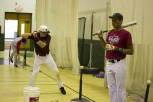 The baseball team was forced to stay inside during the early parts of tryouts because of the weather.