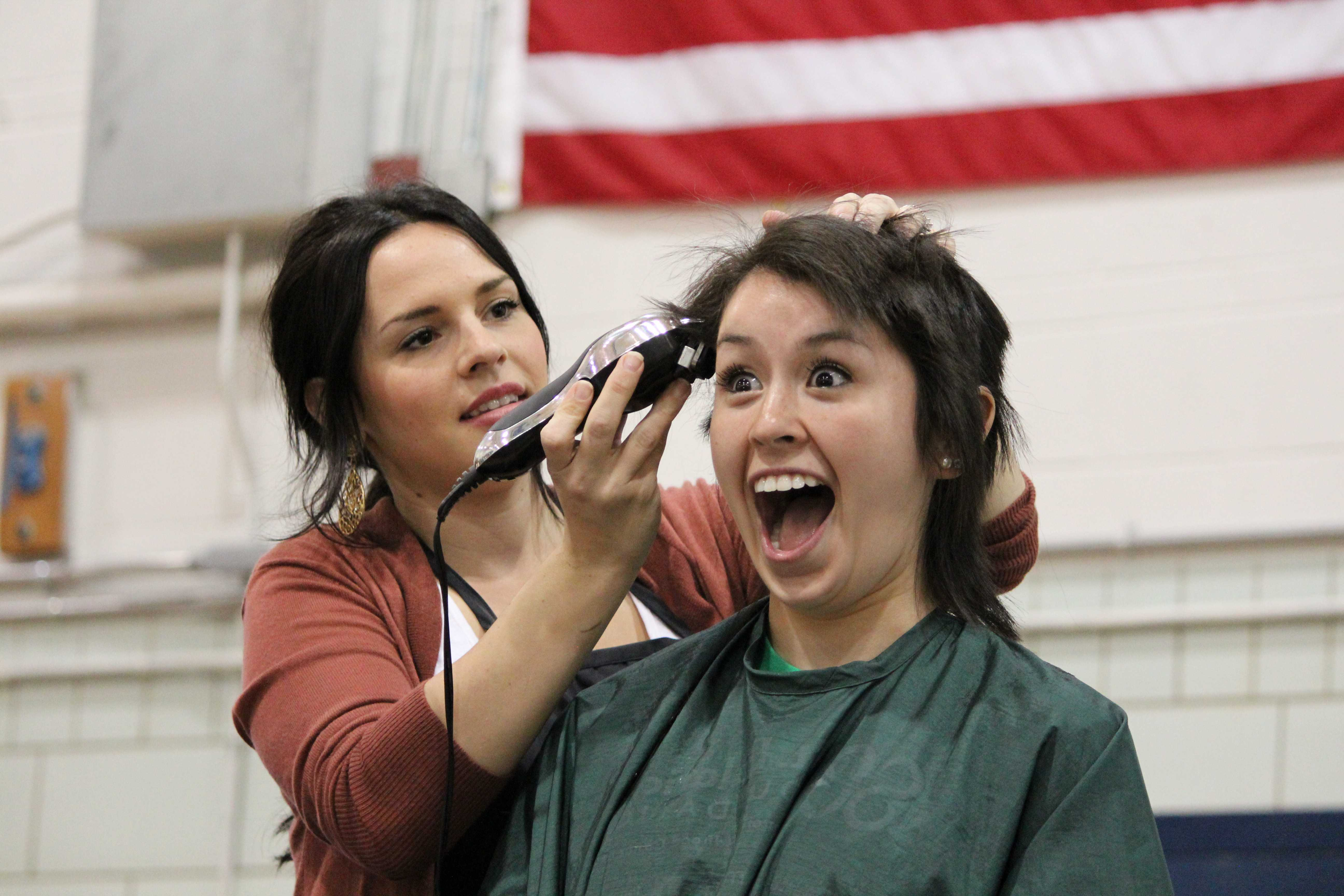 Sophomore Nathalie Solorio getting her hair buzzed off at the St. Baldrick's event for childhood cancer research