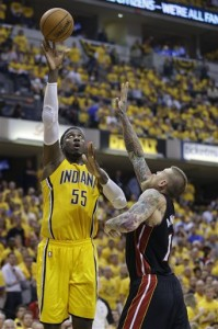 Indiana Pacers center Roy Hibbert, left, shoots over Miami Heat forward Chris Andersen during the fourth quarter of Game 2 of the NBA basketball Eastern Conference finals in Indianapolis, Tuesday, May 20, 2014. The Heat defeated the Pacers 87-83 to tie the series at 1-1. (AP Photo/Michael Conroy)