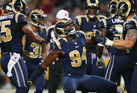 # 94 Robert Quinn of the St. Louis Rams celebrates a sack against the Washington Redskins at the Edward Jones Dome on September 16, 2012 in St. Louis, Missouri.ward Jones Dome on September 16, 2012 in St. Louis, Missouri. (September 15, 20122012-09-15 16:00:00 - Source: Dilip Vishwanat/Getty Images North America)