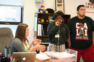 Ms. Eagle assisting students in her 2nd hour class
