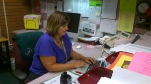 Krohn completing work at her desk.