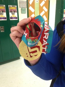 Michelle Cummings displays the medal she won for completing the half marathon.