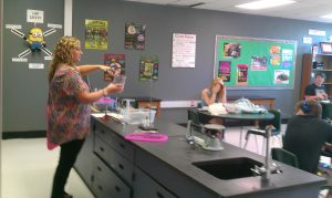 Ms. Walker teaching her class about Science