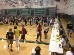 A line forms in the gym on Wednesday morning as students pick up their updated schedules.