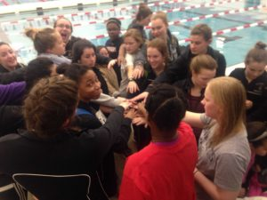 The team rallied together before leaving the meet to do their team chant one last time.