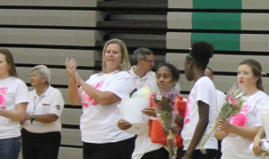 Ms. Becky Middendorf applauds the 2016 seniors as they are recognized during the girls' volleyball senior night.