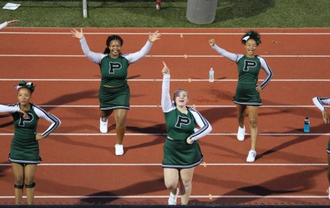 JV cheerleaders were on the track during Homecoming football game