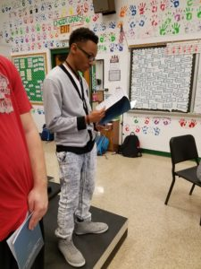 Micah Lee learning music in choir class