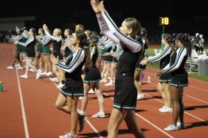 Varsity and JV cheerleaders cheer on the Pattonville football team during the Homecoming game on Sept. 23.