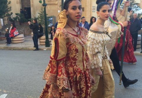Oddo wears a traditional, Renaissance styled dress in a saint festival at her hometown of Sambuca di Sicilia.