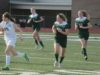 McGehee (back right) runs up the field with fellow teammates Bailey Schaefermeier (center) and Kayla Meyer (back left)