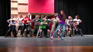 Cast members of Curtains rehearse for the high school musical running Feb. 16-19.