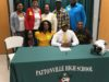 Washington signs to play football at Quincy University