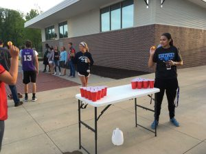 Roma Patel winds up to throw the ping pong ball in a game of Cup Bong.