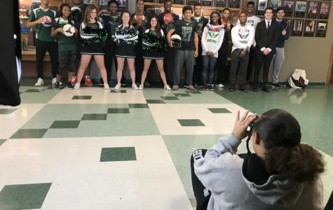 Maddex takes photo of All-National and All-State students for yearbook