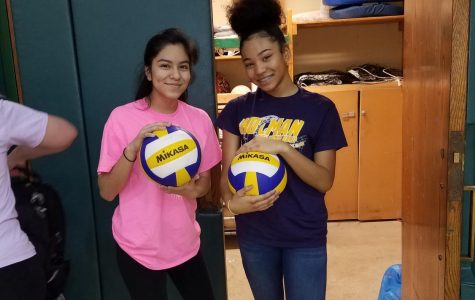 Students help manage the boys' volleyball team