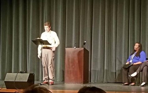 Bachelder reads poem during Writers Week