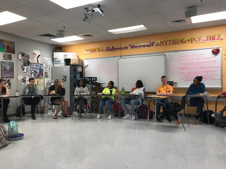 Students participate in socratic discussion.