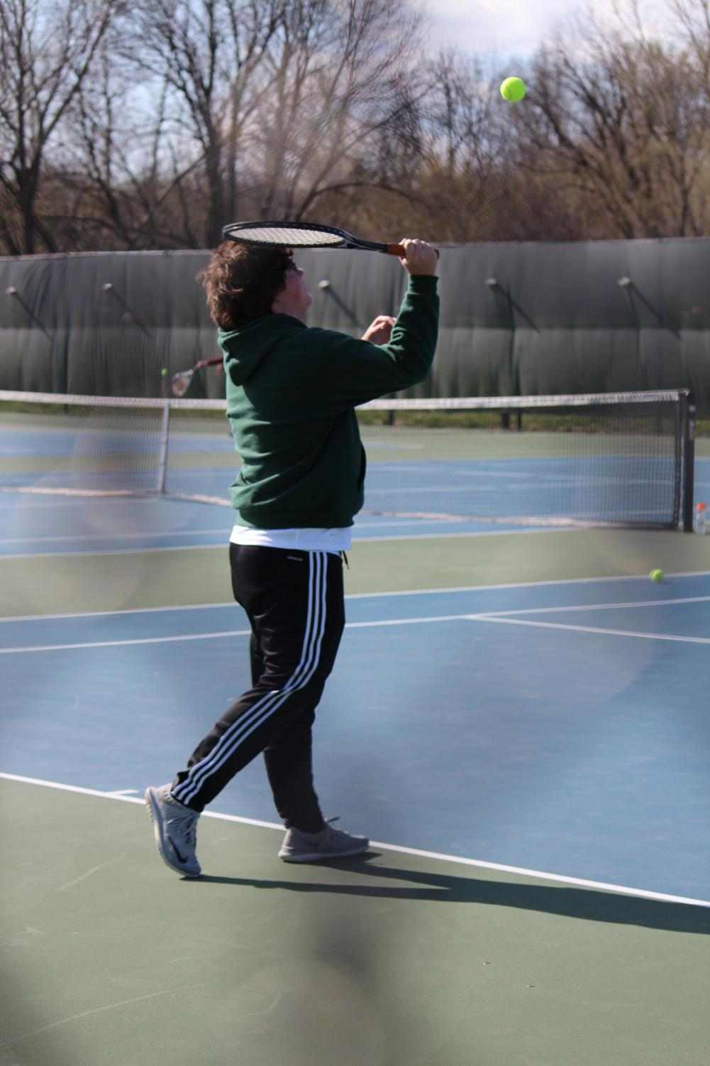 Eric Lee serves during a match earlier in the season at Pattonville High School.