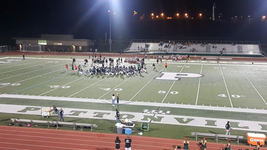 The+Pattonville+and+Webster+Groves+football+teams+kneel+in+respect+for+the+injured+player+as+he+is+being+treated+on+the+field.