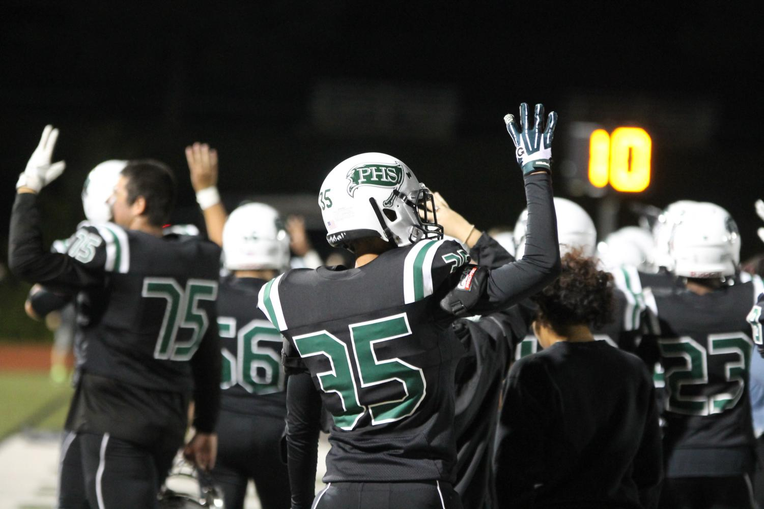 Jacob Whittinghill (35) is playing in his fourth season of football with Pattonville High School. He holds up four fingers as the Pirates start the 4th quarter against Kirkwood on Sept. 21.