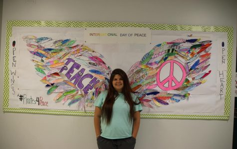 International Club promotes peace with interactive wall mural