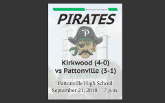 Fans get a free football program as they enter the game against Kirkwood