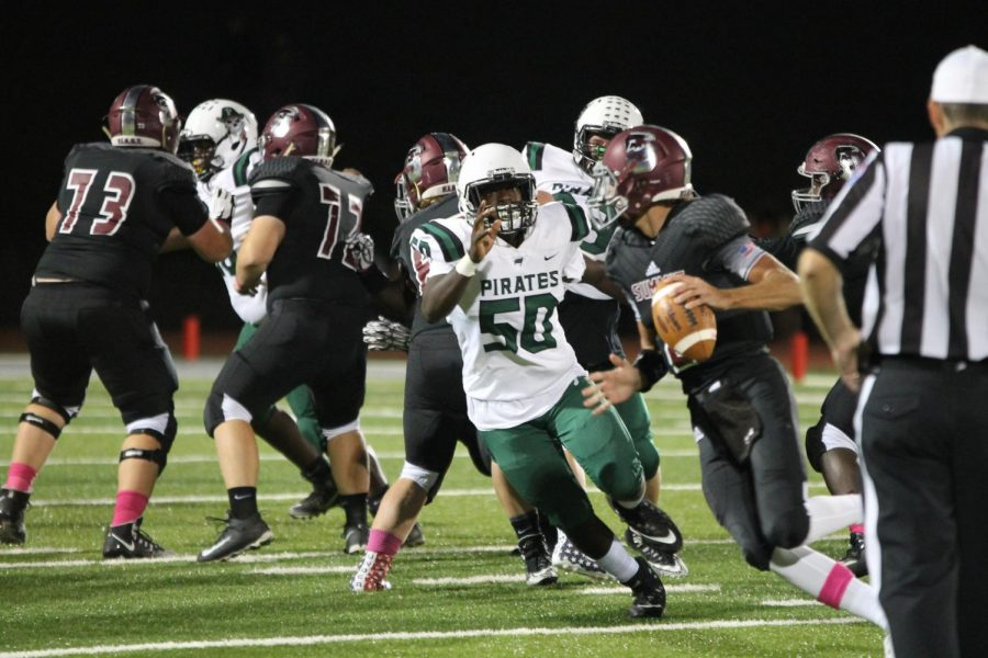 Pattonville%E2%80%99s+senior+OL%2FDE+Darrion+Robinson+chases+down+the+Rockwood+Summit+%0Aquarterback.+The+Pirates+defeated+the+Falcons+42-14.+