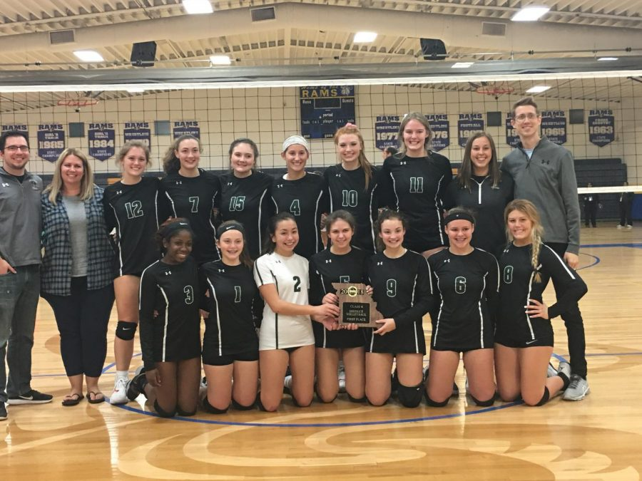 The+girls%27+volleyball+team+holds+the+Class+4+District+5+championship+trophy.+