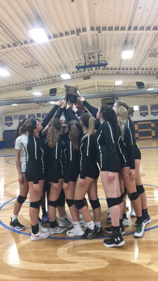 The+Pattonville+girls%27+volleyball+team+holds+up+the+District+championship+trophy+after+their+2-0+victory+against+Hazelwood+West+on+Oct.+25.