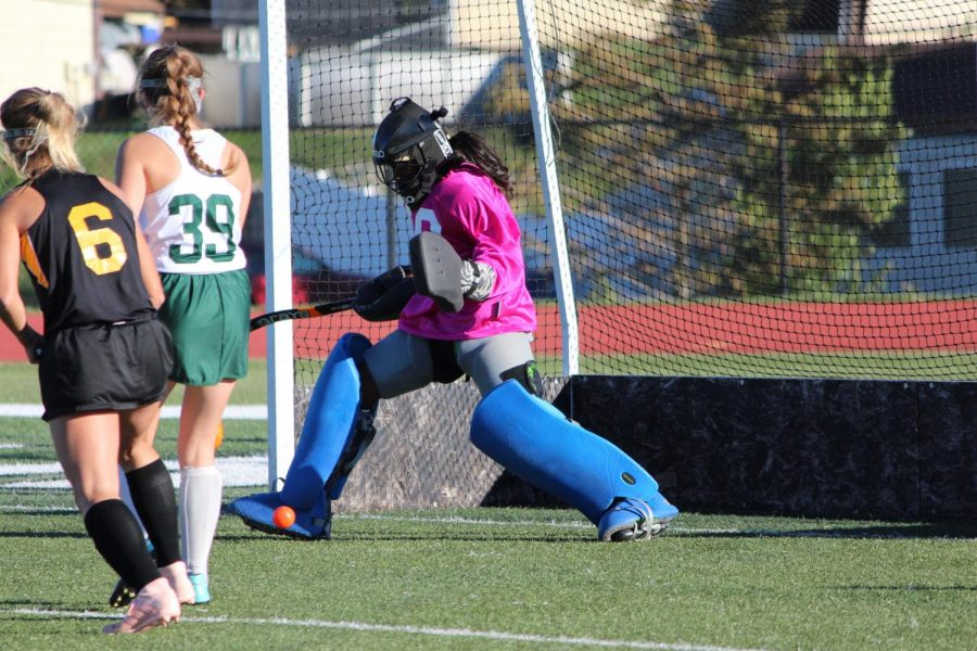 Mikayla+Bridges+makes+a+foot+save+in+the+girls%27+field+hockey+game+on+Senior+Night+against+Oakville.