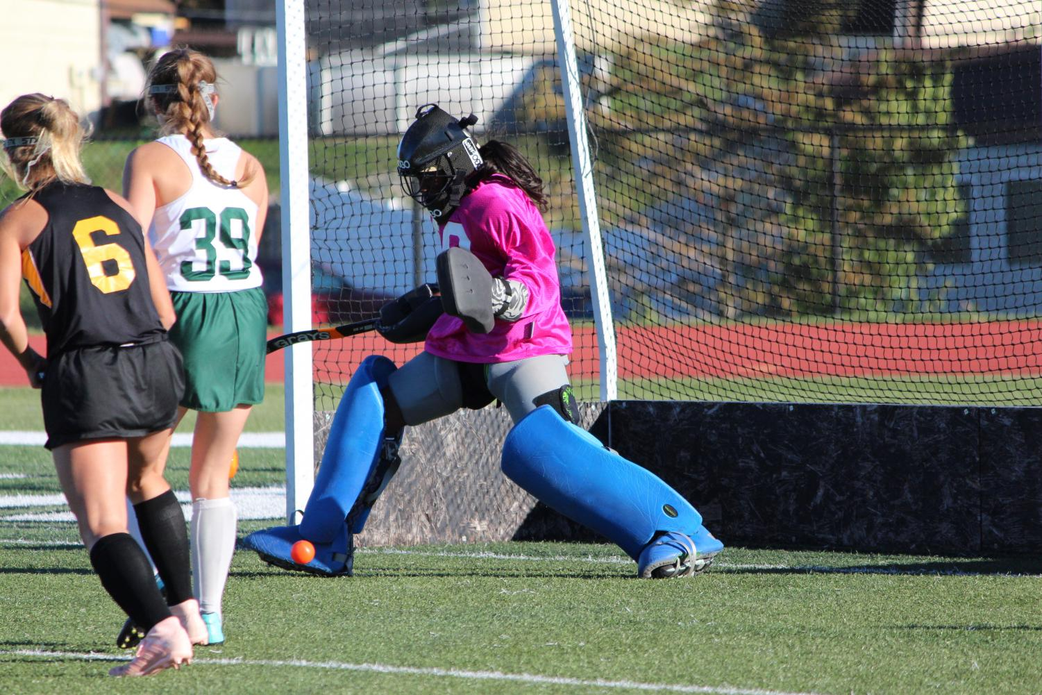 Mikayla Bridges makes a foot save in the girls' field hockey game on Senior Night against Oakville.