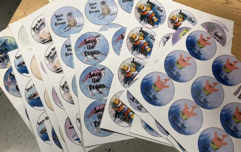Bodde selling Save the Ocean stickers to help benefit an English project