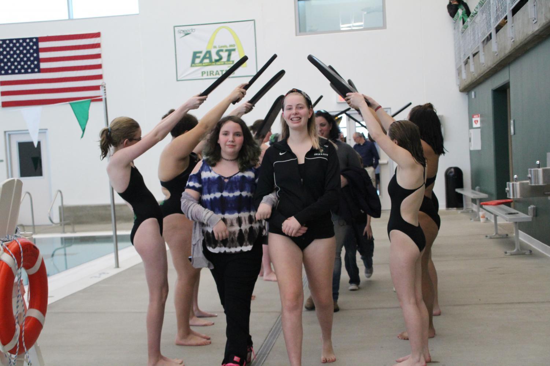 Senior foreign exchange student Marlene Beck is honored during the girls' swimming team Senior Night.