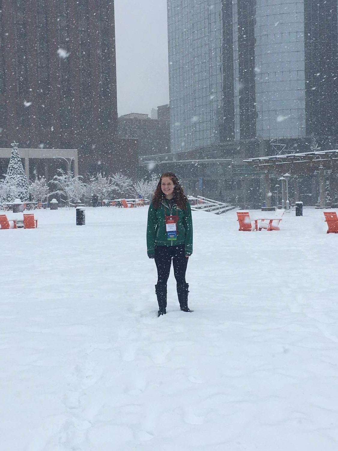 Elise Thompkins stands tall in downtown Kansas City during the snowfall at thescon