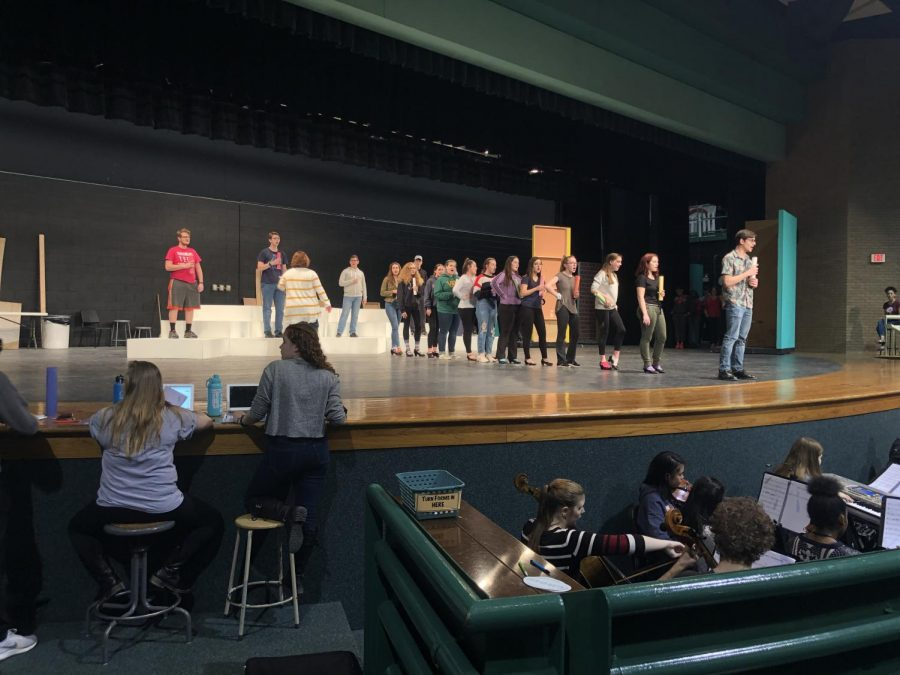 Students+rehearse+the+high+school+production+of+Hairspray.+