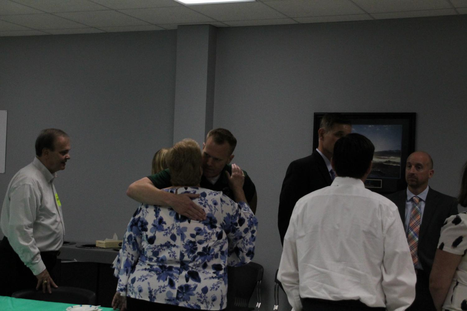 Dr.+Fitzgerald+embraces+an+attendee.+