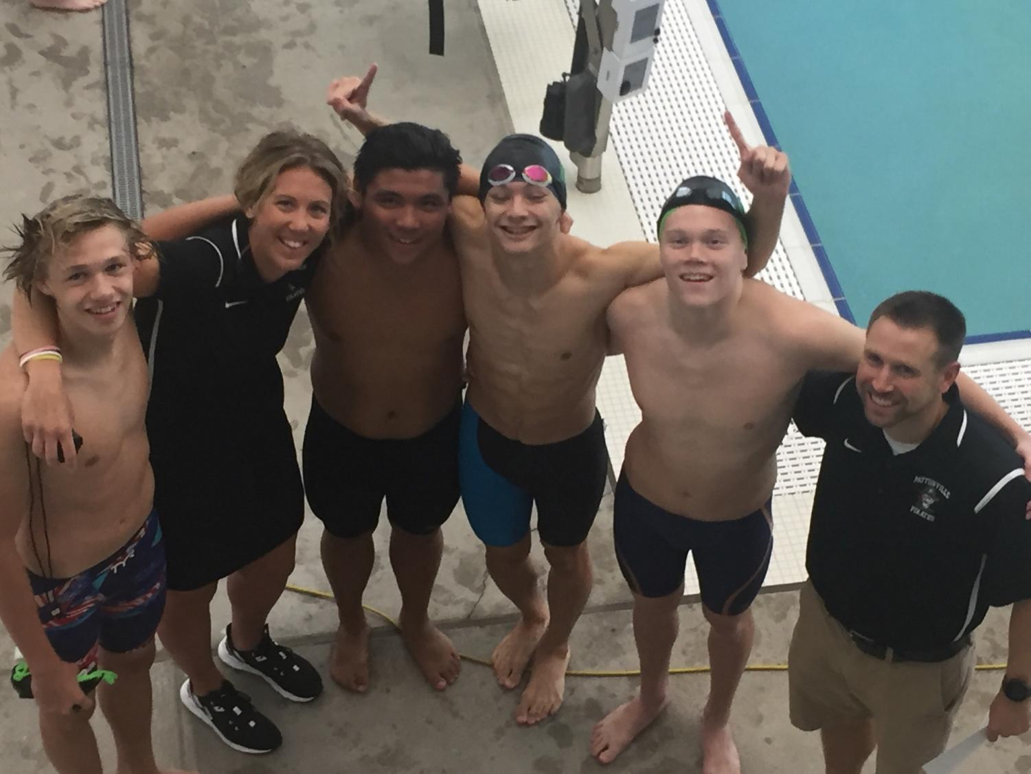 Pirate Swimmers and coaches after breaking the 1983 record for the 200 Medley Relay.