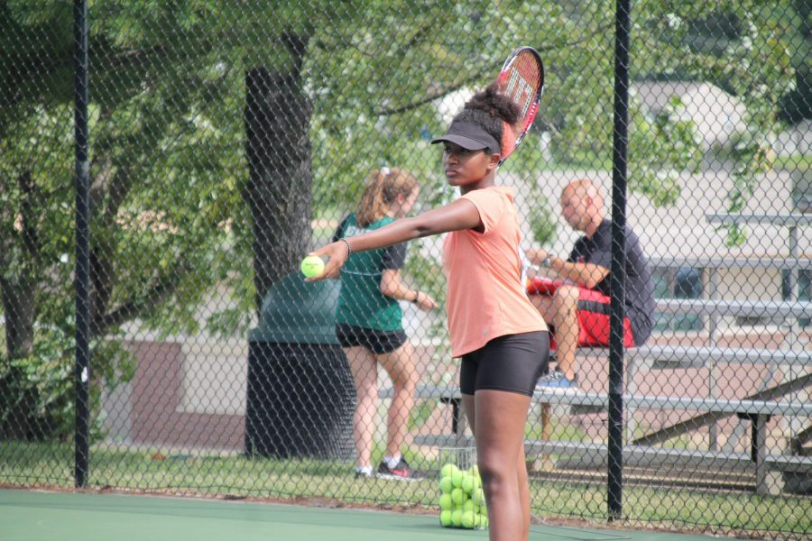Imani+Warren%2C+11th+grade%2C+concentrates+on+perfecting+her+toss+for+her+serve.+