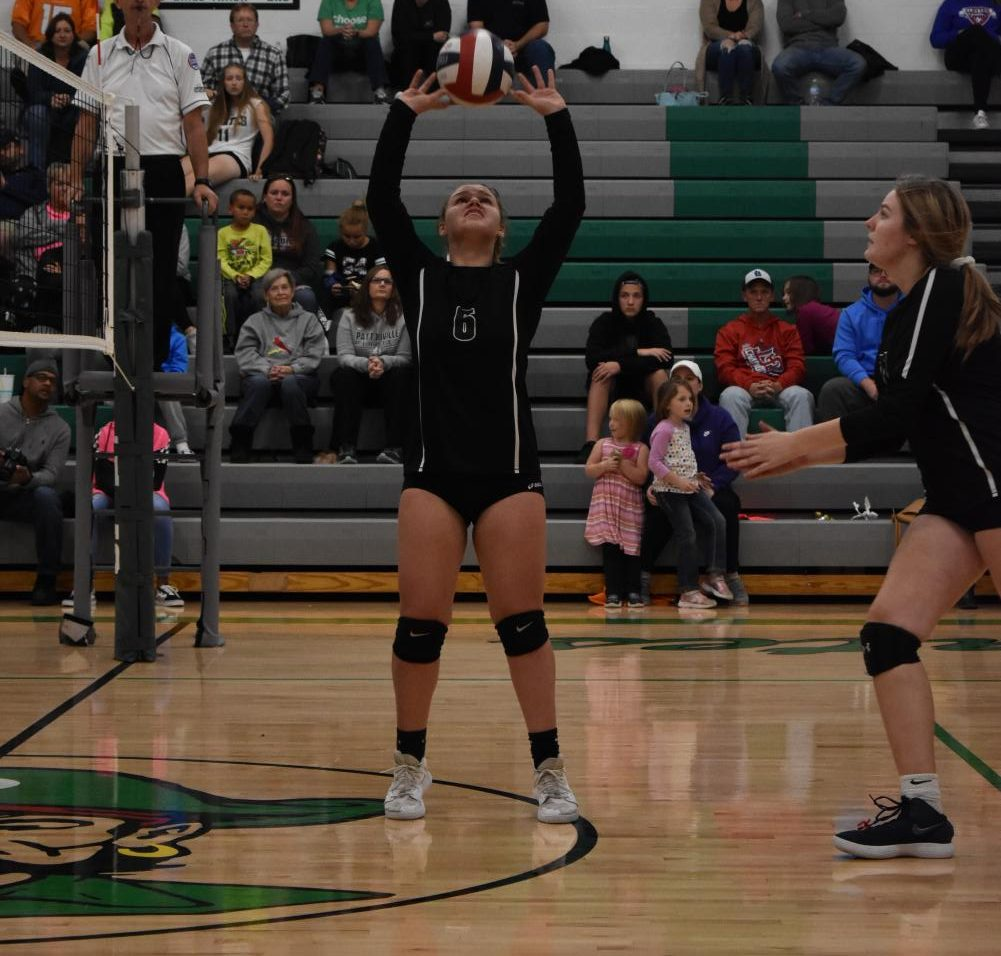 Breaking a record for the most assists in a single game, McKenzie Seagraves sets for Madison Rigsby in the October 11 game against Clayton. The Pirates went on to win 2-1.