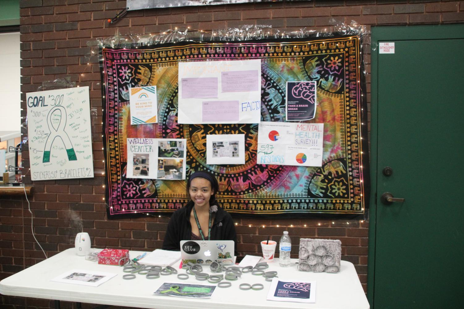 Xmiena Rogers sells bands and stickers to raise money for her wellness center.