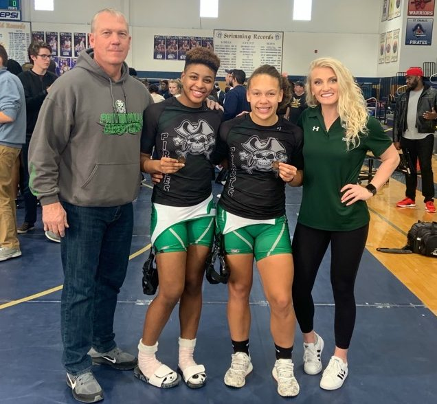 Proud Coaches flank Desire Adams and Autumn Otis, who both took third place in their bracket.
