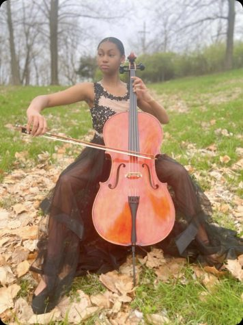 Kenedi Jenkins practicing her cello outside during the Quarantine Break.