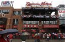 Fans gather outside the new Ballpark Village entertainment complex across the street from Busch Stadium before the start of a baseball game between the St. Louis Cardinals and the Cincinnati Reds Monday, April 7, 2014, in St. Louis. (AP Photo/Jeff Roberson)