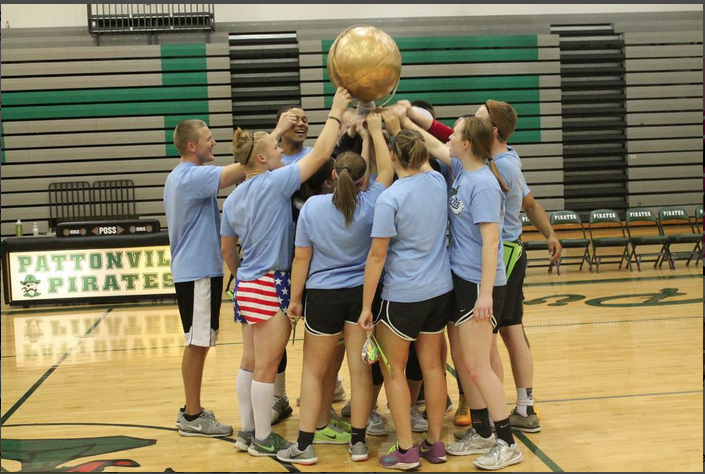 Mr.+Victor+Fink+raises+the+championship+trophy+with+his+team+after+winning+the+Dodgeball+Tournament.+%28file+photo%29