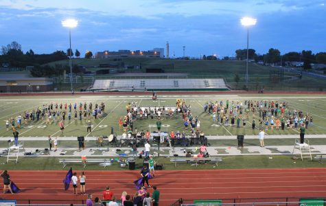 8th grade band students join high school marching band on Oct. 6